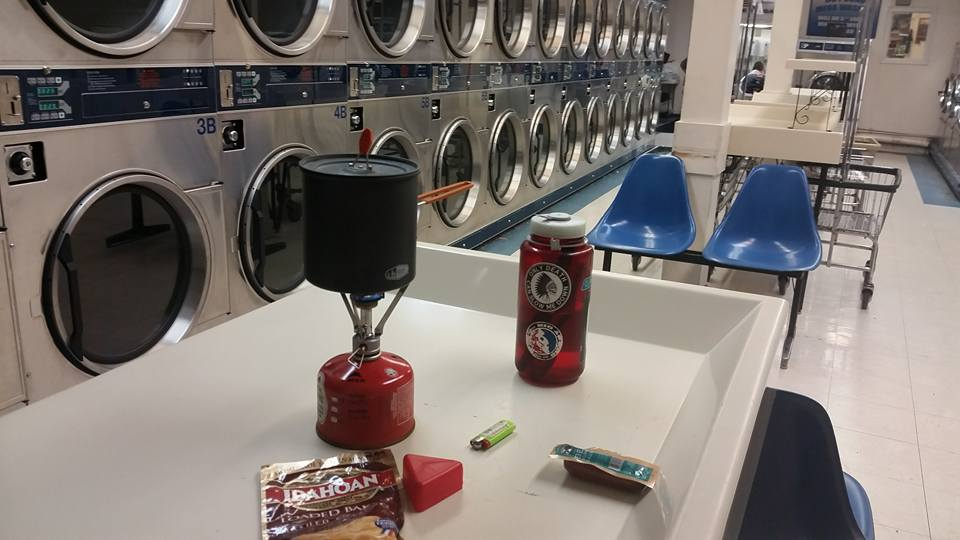 When you're such an advanced level of hiker trash that you're cooking dinner inside a coin laundromat because it's pouring rain outside. Best part is, the attendant has no idea. #hikertrash #dinner #laundry #twobirds #onestone #improvise #adapt #overcome #potatoes #MSR #nalgene — in Front Royal, Virginia.